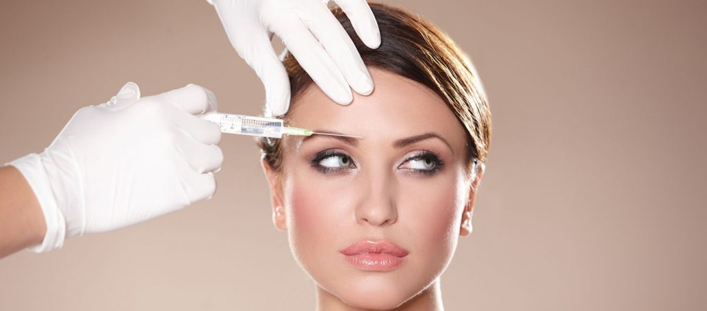 Beautiful woman gets botox injection in her face